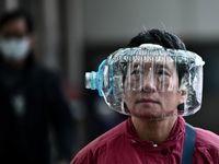 استفاده از ماسکهای عجیب در چین +عکس