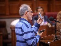 نجفی در دادگاه دست به اسلحه شد! +تصاویر