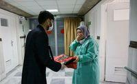 اهدا تبرکی آستان قدس و حرم حضرت عباس(ع) در بیمارستان کامکار +تصاویر