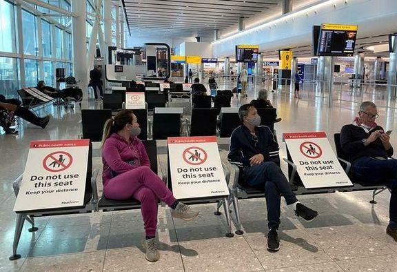 حفظ فاصله اجتماعی در فرودگاه لندن +عکس