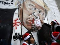 نقاشی دیواری تصویر ترامپ روی دیوار شهر بیتلحم +عکس