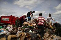 کودکان زباله گرد، معلق میان قانون و پول!