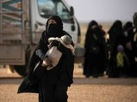 خروج گردان زنان داعشی از دیرالزور +تصاویر