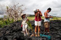 مبارزه مردم هاوایی با بقایای گدازههای آتشفشان +تصاویر